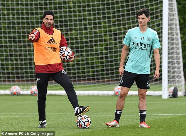 Patino (right) has been involved in some first-team training sessions held by Mikel Arteta (left)